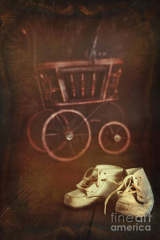 Sandra Cunningham - Antique doll carriage with baby shoes in foreground