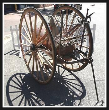 Gail Matthews - Antique Fire Extinguisher Wagon Wheels