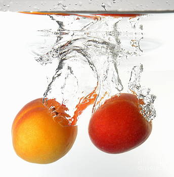 Apricots fruits underwater by Sami Sarkis