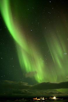 Aurora over village by Derek Sherwin