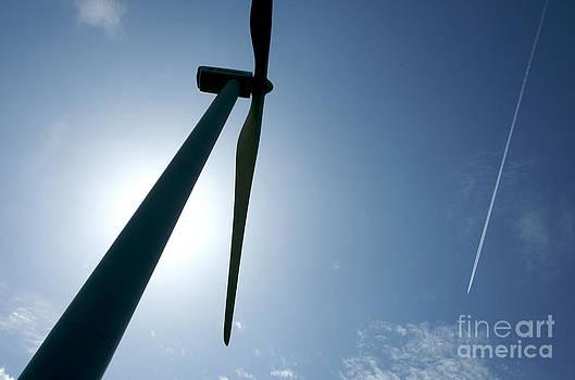 BERNARD JAUBERT - Backlighting of a wind turbine and plane.