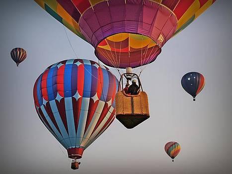 Balloons lifting Off by Greg Bush