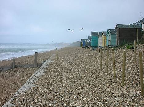 Beach Huts and Kite surfers by Adrian Hillyard