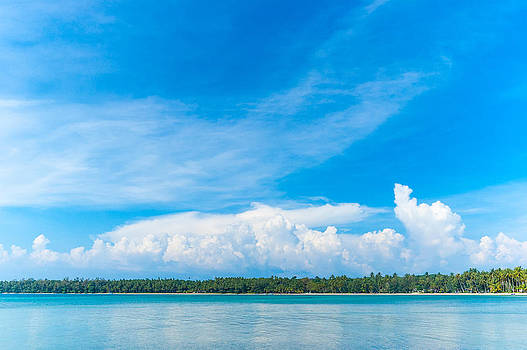 Beautiful Cloudscape On Vivid Blue Sky Reflecting On The Sea At  by Jirawat Cheepsumol