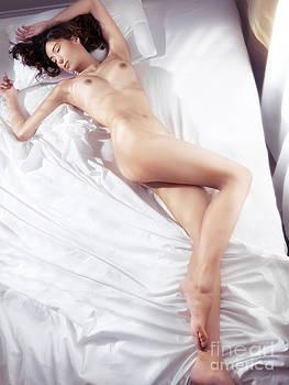 Beautiful woman sleeping naked in bed lit by sunlight by Oleksiy Maksymenko