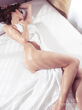 Beautiful young woman sleeping naked in bed by Oleksiy Maksymenko