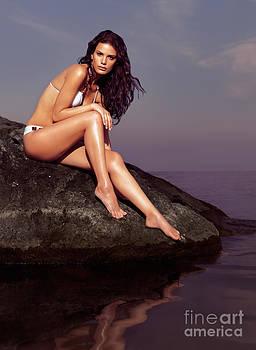 Beautiful Young Woman Wearing Bikini Sitting on Rock by Oleksiy Maksymenko