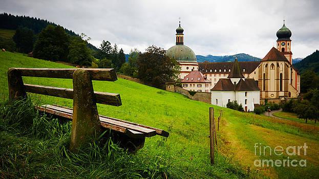 Nick  Biemans - Bench overlooking a historic monastery