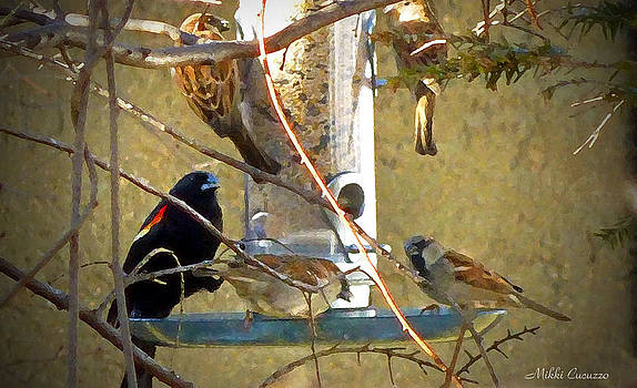 Birds at the feeder by Mikki Cucuzzo