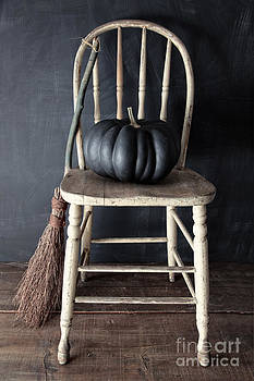 Sandra Cunningham - Black pumpkin on chair with old broom