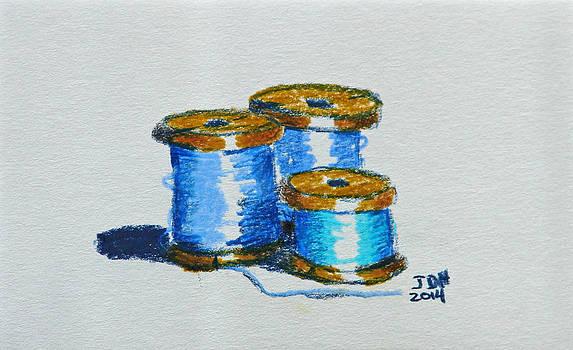 Blue spools of thread by Joseph Hawkins