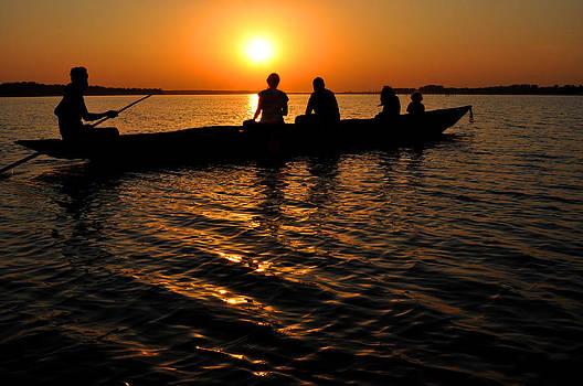 Boat in sunset on Chilika Lake India by Diane Lent