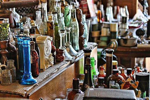 Bottles in the Old Stuff Shop by Lynn Jordan