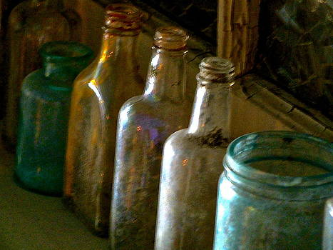 Bottles on shelf by Lesley McCormack