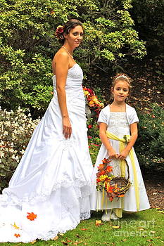 Bride and Flower Girl by Jay Nodianos