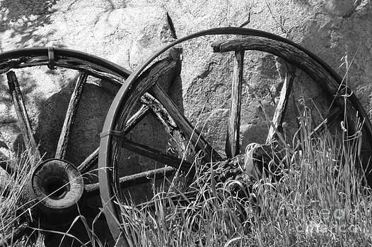 Broken Rims by Mary Mikawoz