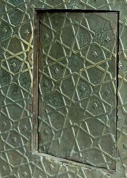 Bronze door in a door by Russell Smidt