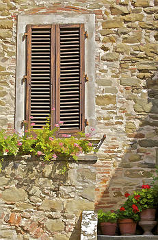 David Letts - Brown Wood Window Shutters with Flowers in a Medieval Village in Tuscany