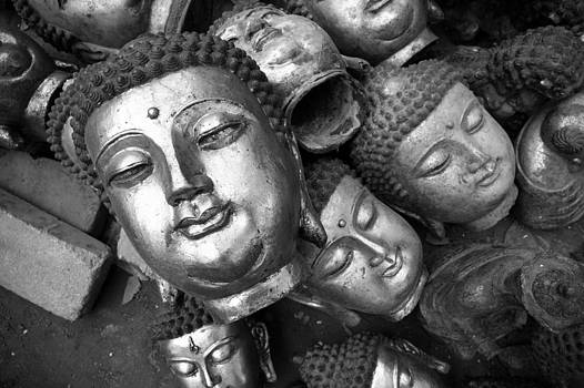 Buddha statues  by Kam Chuen Dung