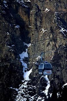cableway funicular and rocks of the Trans-Ili Alatau mountain range.   by Daliya Photography