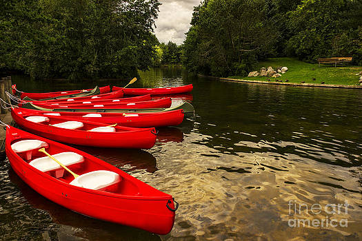 Canoes on a lake by Gry Thunes