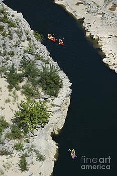 BERNARD JAUBERT - Canoes on the river Ardeche in southern France