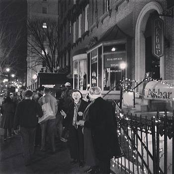 Carolers on North Charles Street December 2013 by Toni Martsoukos