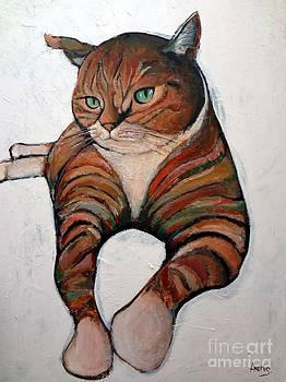 Cat Relaxing On The Floor by Aeris Osborne