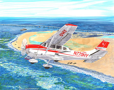 Jack Pumphrey - Cessna 206 flying over the outer banks