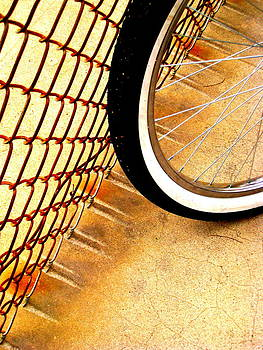 Chain Link Fence Scrapes Concrete by John King