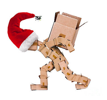 Christmas character carrying a large box  by Simon Bratt Photography LRPS