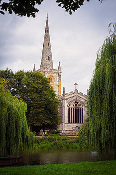 Church across the river by Trevor Wintle