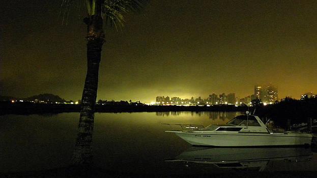 City lights behind the sea by Jose Francisco Abreu