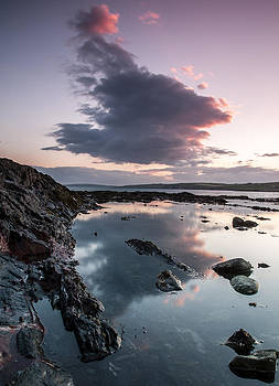 Cloud reflection at Garretstown beach by M I