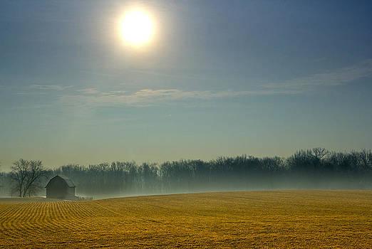 Cold sunrise over farmland in central Indiana by Michael Huddleston