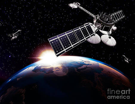 Communication satellites in space above Earth with rising sun by Oleksiy Maksymenko