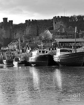 Conwy Harbour and Castle. by Adrian Hillyard