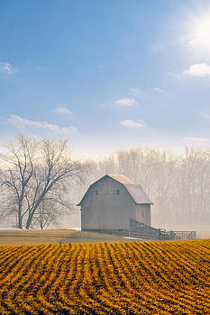 Country barn waking up to a cold morning sunrise in central Indiana by Michael Huddleston