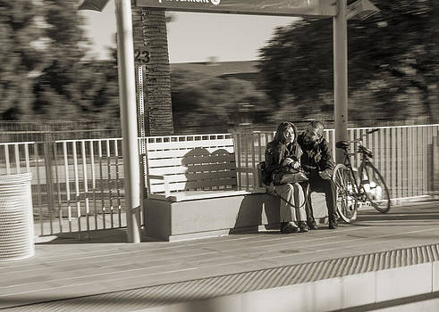 Couple waiting for the train by Kim M Smith