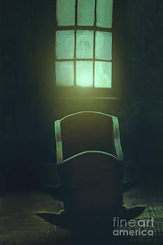 Sandra Cunningham - Creepy wooden in front of window