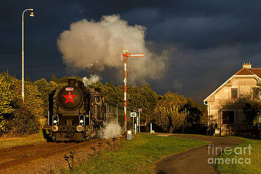 Czech steam locomotive with storm clouds by Christian Spiller