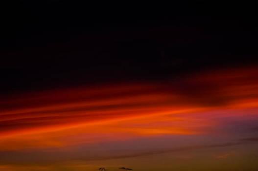 Dark sunset over a mountain peak by Lehua Pekelo-Stearns