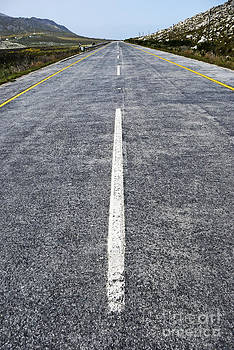 Dividing line on a highway road by Sami Sarkis