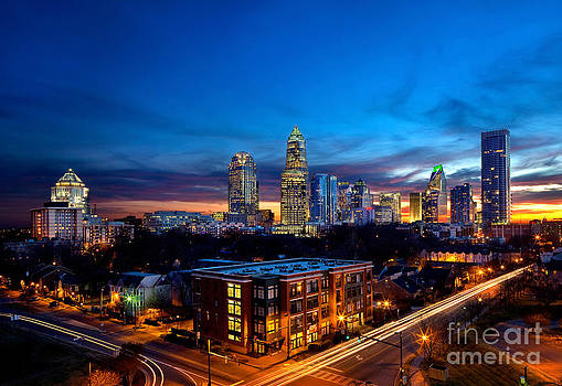 Downtown Charlotte with skyline in background by Patrick Schneider
