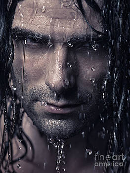 Dramatic portrait of man wet face with long hair by Oleksiy Maksymenko