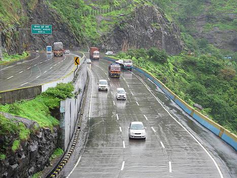 Expressway on a rainy day by Joe Zachariah
