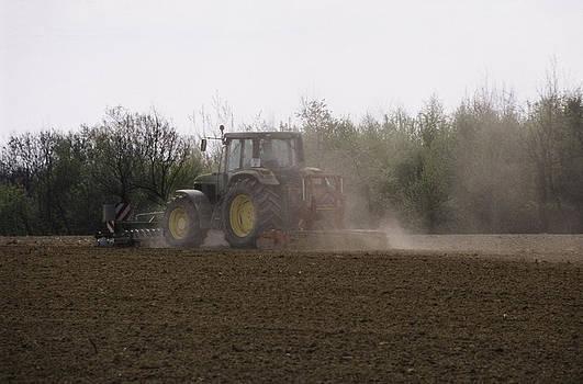 Farmer at work by Patrick Kessler