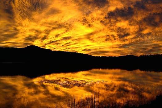 Fiery Sunrise Over Medicine Lake by Rich Rauenzahn