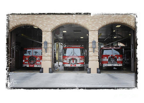 Fire Trucks at the LAFD Fire Station are decorated for Christmas by Nina Prommer