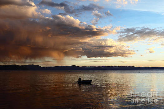 James Brunker - Fisherman at Sunset on Lake Titicaca